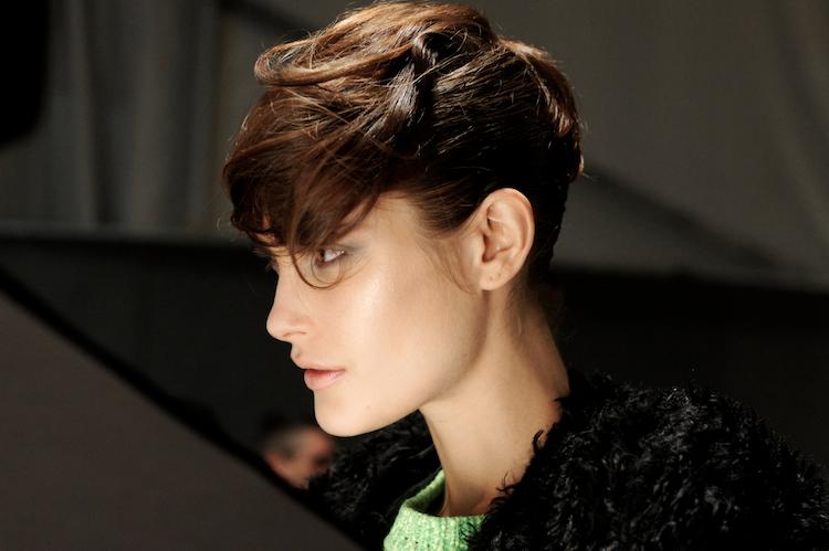 model backstage milan fashion week