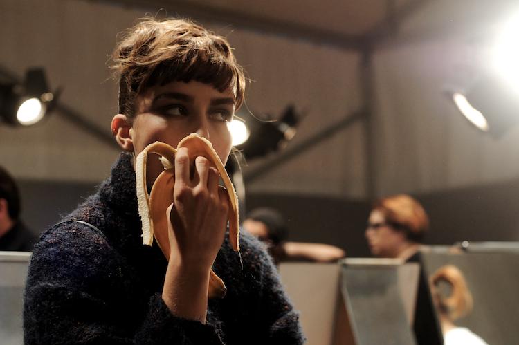 model eating a banana