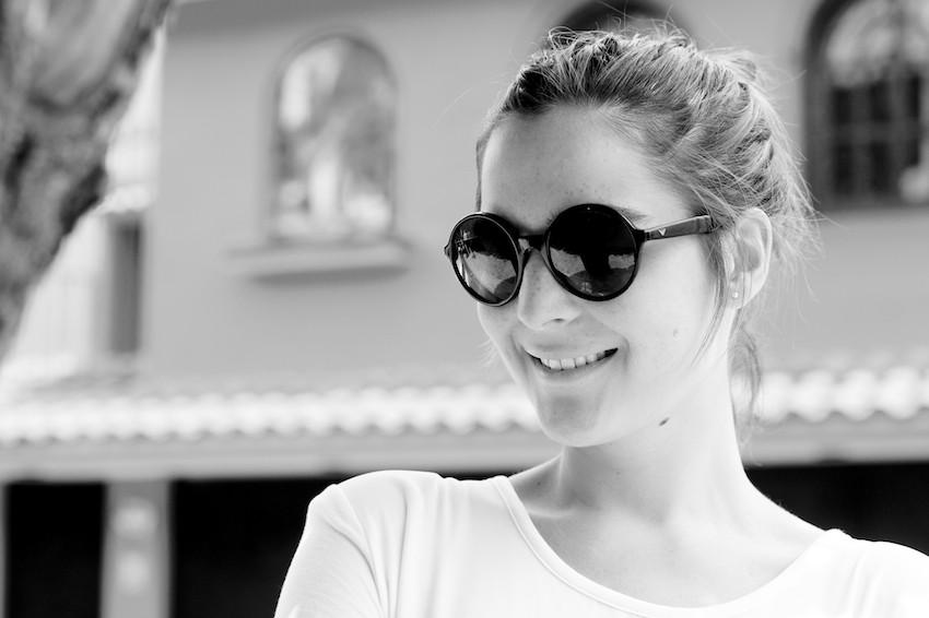 round sunglasses in black by emporio armani
