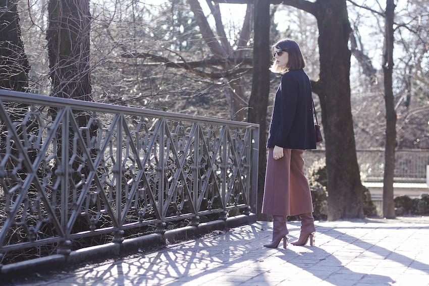 irene buffa wearing an oversize blazer , culottes trousers outfit , gianmarco lorenzi boots